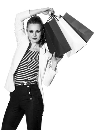 Luxury Shopping. The French way. Portrait of young fashion-monger in white jacket isolated on white background with shopping bags painted in the color of the French flag