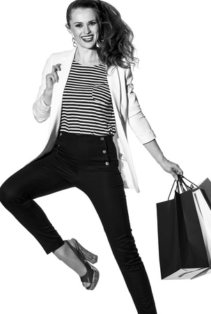Luxury Shopping. The French way. cheerful stylish woman in white jacket isolated on white background with shopping bags painted in the color of the French flag