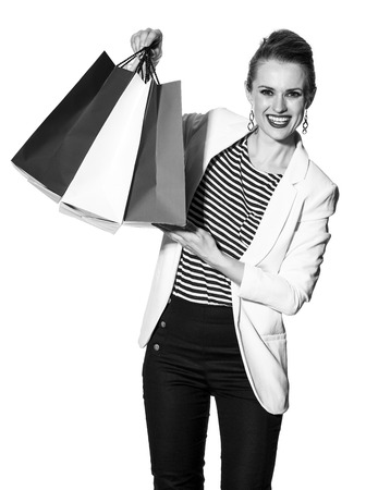 Luxury Shopping. The French way. happy young fashion-monger in white jacket isolated on white background showing shopping bags painted in the color of the French flag