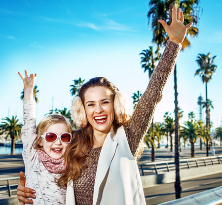 in Barcelona for a perfect winter. smiling young mother and child tourists in Barcelona, Spain rejoicing Stock Photo