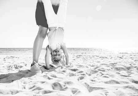 Colorful and wonderfully cheerful mood. mother and smiling child in colorful clothes on the seashore having fun time 스톡 콘텐츠
