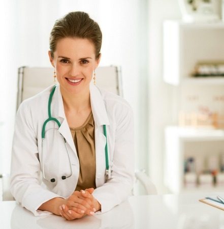 smiling doctor woman in office Stock Photo