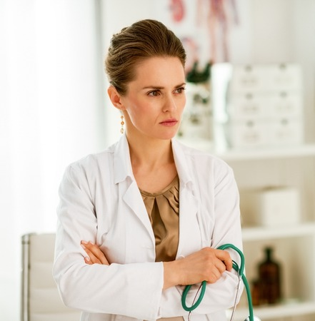 Modern health care. pensive female doctor in the office