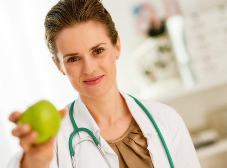 Doctor woman showing apple Stock Photo
