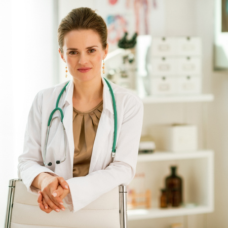 happy medical doctor woman in office