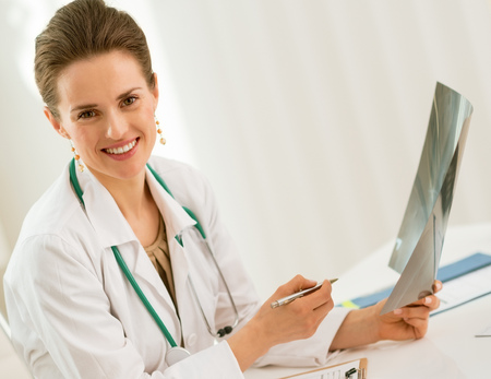 happy doctor woman holding fluorography in office
