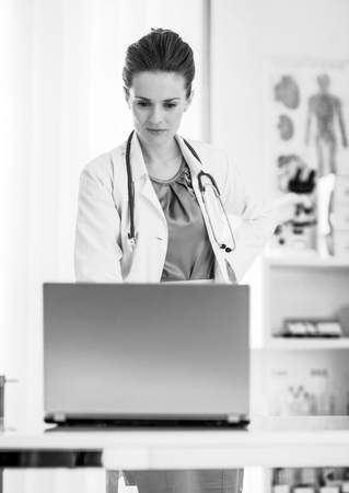 Medical doctor woman looking in laptop Stock Photo