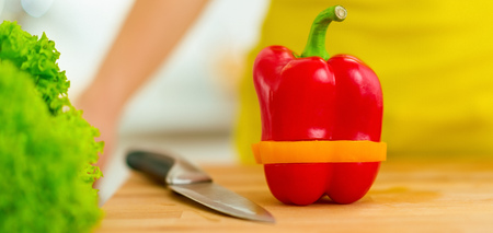 Closeup on red bell pepper with yellow slice Stok Fotoğraf - 100138647