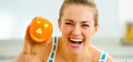 happy young woman showing halloween orange Banco de Imagens