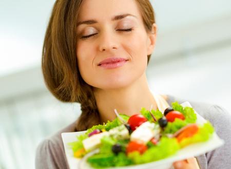 young housewife enjoying fresh salad