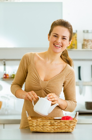 Smiling young housewife serving breakfast tray Reklamní fotografie