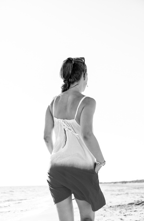wonderfully cheerful mood. young woman in dress on the seacoast in the evening walking Stock Photo