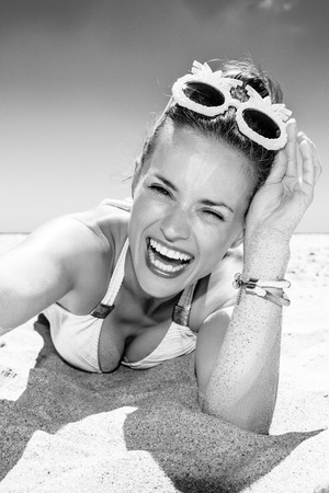 Fun on white sand. happy modern woman in sunglasses and swimsuit on the beach taking selfie