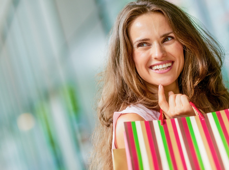 happy young woman with shopping bags 스톡 콘텐츠