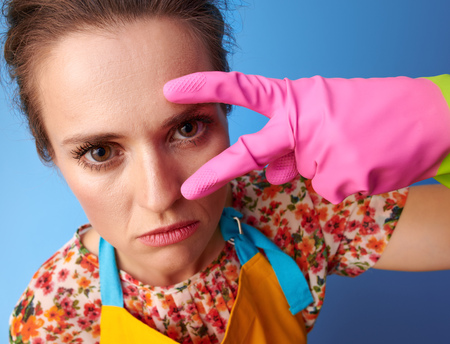 Big cleaning time. modern housewife with rubber gloves on blue background