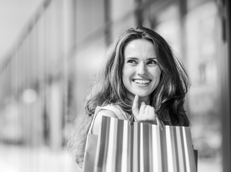Portrait of happy young woman with shopping bags Reklamní fotografie