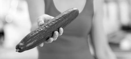 Closeup on cucumber in hand of woman Banco de Imagens