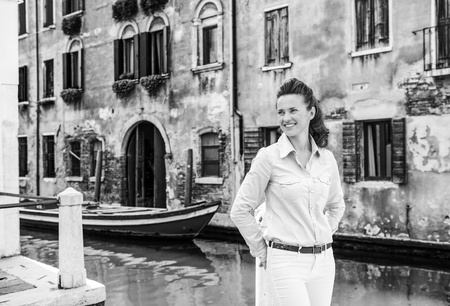 Portrait of happy young woman in venice, italy 写真素材