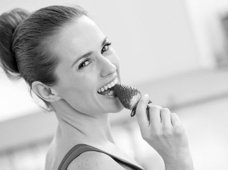 happy young woman eating strawberry Stock Photo