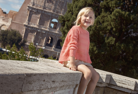 Happy trendy child in Rome, Italy