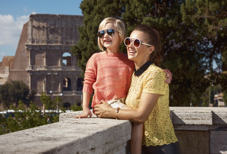 Happy young mother and child tourists in Rome, Italy having excursion