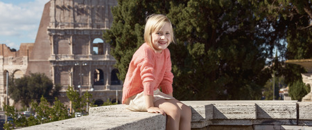 Happy modern child not far from Colosseum