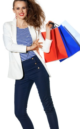 Luxury Shopping. The French way. smiling young fashion-monger in white jacket isolated on white background with shopping bags painted in the color of the French flag