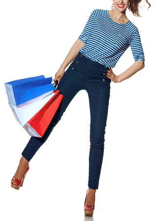 Shopping. The French way. Closeup on happy modern fashion-monger holding shopping bags of the colours of the French flag isolated on white background Stockfoto