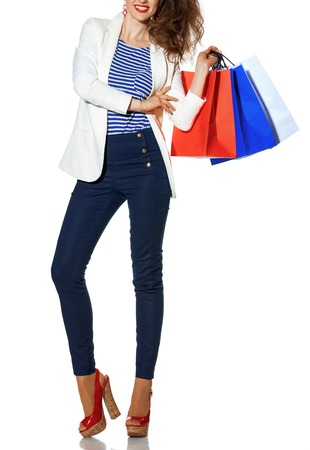 Luxury Shopping. The French way. Closeup on smiling young fashion-monger in white jacket isolated on white background with shopping bags painted in the color of the French flag