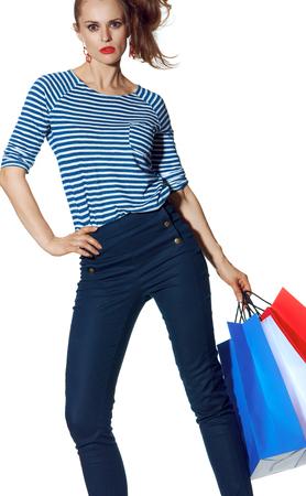 Shopping. The French way. stylish fashion-monger with shopping bags of the colours of the French flag standing isolated on white background