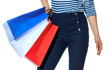 Shopping. The French way. Closeup on modern woman with shopping bags of the colours of the French flag isolated on white Stockfoto