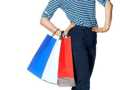 Shopping. The French way. Closeup on modern woman with shopping bags of the colours of the French flag isolated on white background Stockfoto
