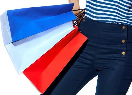 Shopping. The French way. Closeup on stylish woman with shopping bags of the colours of the French flag isolated on white background Stockfoto