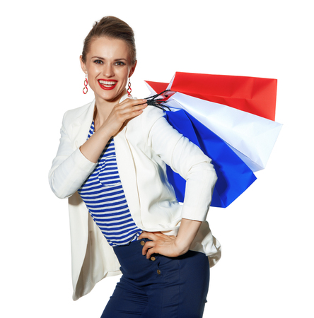 Luxury Shopping. The French way. Portrait of smiling modern woman in white jacket isolated on white background with shopping bags painted in the color of the French flag