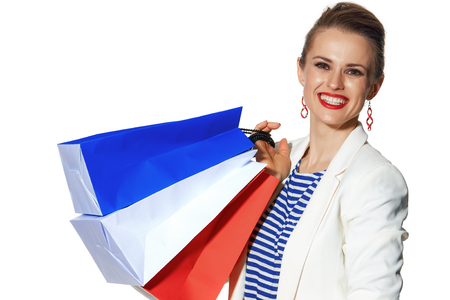 Luxury Shopping. The French way. happy trendy fashion-monger in white jacket isolated on white background with shopping bags painted in the color of the French flag Stock Photo