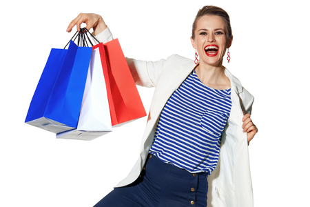Luxury Shopping. The French way. happy young fashion-monger in white jacket isolated on white showing shopping bags painted in the color of the French flag