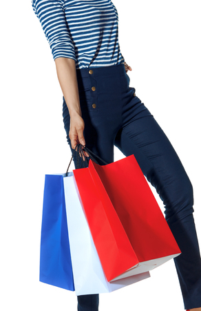 Shopping. The French way. Closeup on modern fashion-monger with shopping bags of the colours of the French flag isolated on white walking Standard-Bild - 108358896