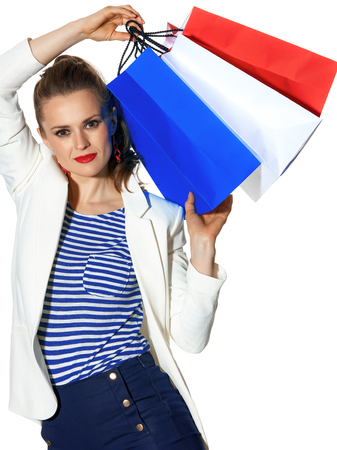 Luxury Shopping. The French way. young fashion-monger in white jacket isolated on white background with shopping bags painted in the color of the French flag