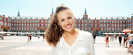 Portrait of happy stylish traveller woman at Plaza Mayor