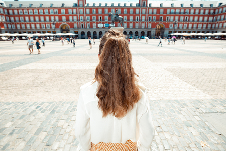 Seen from behind stylish woman at Plaza Mayor