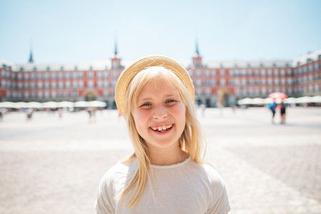 Portrait of happy child in straw hat at Plaza Mayor Editorial