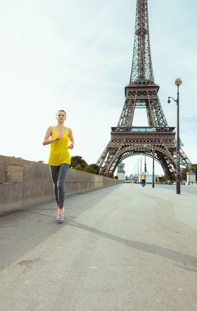 fit woman in fitness clothes in Paris, France jogging. Stock Photo