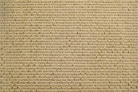 lurex: Beige natural linen fabric with brilliance golden lurex close-up. Aida texture for the background