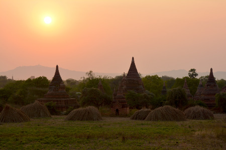 Beautiful ancient pagodas at the sunset in Bagan archaeological zone, Myanmar (Burma).