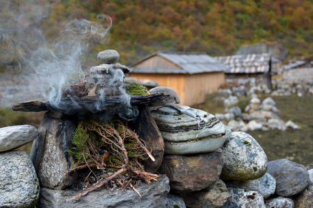 tibetian: Burning juniper twigs - tibetian ritual tribute to the spirits for protection and good luck.