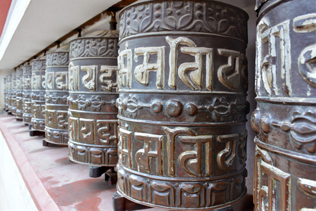 Buddhist tibetian prayer wheels in Kathmandu, Nepal Stock Photo