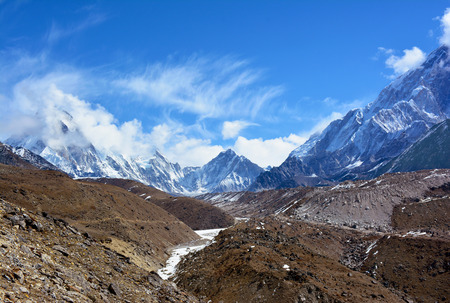 icefall: Beautiful Himalayan Mountains covered with clouds on the way to Everest basecamp, Nepal.
