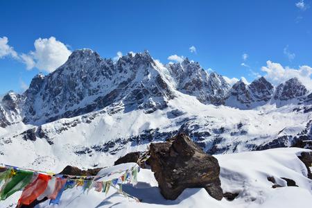 tibetian: Majestic Himalayan mountains, Nepal. Big stone and tibetian prayer flags on the foreground.