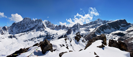tibetian: Panorama from the top of the mountain Gokyo Ri, Nepal. Beautiful Himalayan mountains on the background of blue sky. Stock Photo
