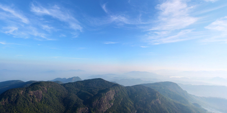 Beautiful panoramic view of the misty mountains and valley from the top of the the Adams Peak, Sri Lanka Stock Photo